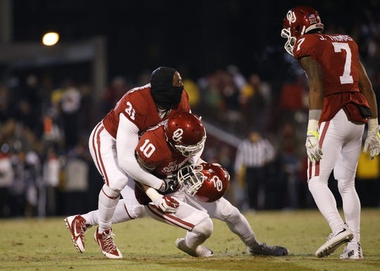 Nov 21, 2015; Norman, OK, USA; Oklahoma Sooners safety Steven Parker (10) celebrates with linebacker Ogbonnia Okoronkwo (31) and cornerback Jordan Thomas (7) after deflecting a pass on a two point conversion try by the TCU Horned Frogs during the fourth quarter at Gaylord Family - Oklahoma Memorial Stadium. Mandatory Credit: Kevin Jairaj-USA TODAY Sports