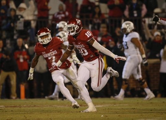 Nov 21, 2015; Norman, OK, USA; Oklahoma Sooners safety Steven Parker (10) celebrates after deflecting a pass attempt by TCU Horned Frogs quarterback Bram Kohlhausen (not pictured) on a two point conversion try during the fourth quarter at Gaylord Family - Oklahoma Memorial Stadium. Mandatory Credit: Kevin Jairaj-USA TODAY Sports