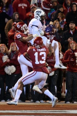 Nov 21, 2015; Norman, OK, USA; TCU Horned Frogs wide receiver Emanuel Porter (1) catches a touchdown pass in front of Oklahoma Sooners cornerback Zack Sanchez (15) during the fourth quarter at Gaylord Family - Oklahoma Memorial Stadium. Mandatory Credit: Mark D. Smith-USA TODAY Sports
