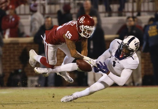 Nov 21, 2015; Norman, OK, USA; Oklahoma Sooners cornerback Zack Sanchez (15) breaks up a pass intended for TCU Horned Frogs wide receiver Emanuel Porter (1) during the second half at Gaylord Family - Oklahoma Memorial Stadium. Mandatory Credit: Kevin Jairaj-USA TODAY Sports