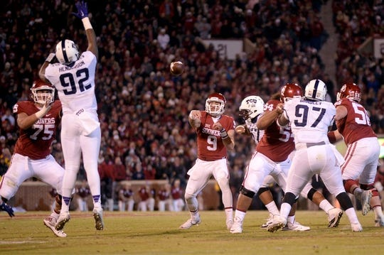 Nov 21, 2015; Norman, OK, USA; Oklahoma Sooners quarterback Trevor Knight (9) passes the ball against the TCU Horned Frogs during the third quarter at Gaylord Family - Oklahoma Memorial Stadium. Mandatory Credit: Mark D. Smith-USA TODAY Sports