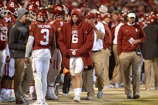Nov 21, 2015; Norman, OK, USA; Oklahoma Sooners quarterback Baker Mayfield (6) walks on the sideline after being injured in action against the TCU Horned Frogs at Gaylord Family - Oklahoma Memorial Stadium. Mandatory Credit: Mark D. Smith-USA TODAY Sports