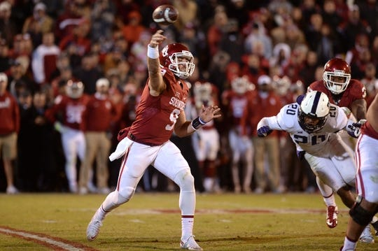 Nov 21, 2015; Norman, OK, USA; Oklahoma Sooners quarterback Trevor Knight (9) passes the ball against the TCU Horned Frogs during the fourth quarter at Gaylord Family - Oklahoma Memorial Stadium. Mandatory Credit: Mark D. Smith-USA TODAY Sports