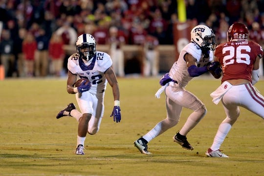 Nov 21, 2015; Norman, OK, USA; TCU Horned Frogs running back Aaron Green (22) runs the ball against the Oklahoma Sooners during the fourth quarter at Gaylord Family - Oklahoma Memorial Stadium. Mandatory Credit: Mark D. Smith-USA TODAY Sports