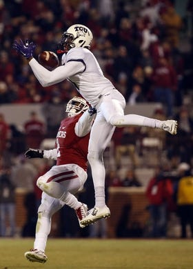 Nov 21, 2015; Norman, OK, USA; TCU Horned Frogs wide receiver Emanuel Porter (1) goes up for a catch as Oklahoma Sooners linebacker Dominique Alexander (1) defends during the game at Gaylord Family - Oklahoma Memorial Stadium. Mandatory Credit: Kevin Jairaj-USA TODAY Sports