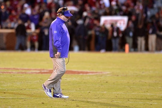 Nov 21, 2015; Norman, OK, USA; TCU Horned Frogs head coach Gary Patterson walks off of the field after play against the Oklahoma Sooners at Gaylord Family - Oklahoma Memorial Stadium. Mandatory Credit: Mark D. Smith-USA TODAY Sports