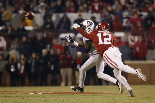 Nov 21, 2015; Norman, OK, USA; TCU Horned Frogs wide receiver KaVontae Turpin (25) catches a pass past Oklahoma Sooners cornerback William Johnson (12) during the second half at Gaylord Family - Oklahoma Memorial Stadium. Mandatory Credit: Kevin Jairaj-USA TODAY Sports