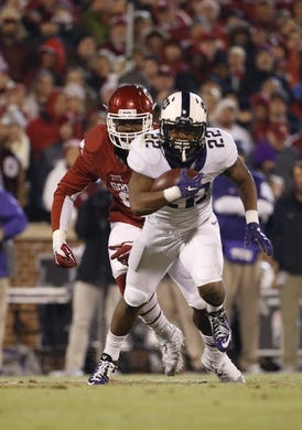 Nov 21, 2015; Norman, OK, USA; TCU Horned Frogs running back Aaron Green (22) runs during the game against the Oklahoma Sooners at Gaylord Family - Oklahoma Memorial Stadium. Mandatory Credit: Kevin Jairaj-USA TODAY Sports