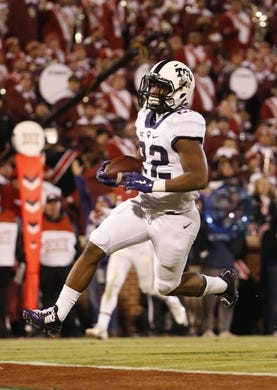 Nov 21, 2015; Norman, OK, USA; TCU Horned Frogs running back Aaron Green (22) runs for a touchdown during the game against the Oklahoma Sooners at Gaylord Family - Oklahoma Memorial Stadium. Mandatory Credit: Kevin Jairaj-USA TODAY Sports