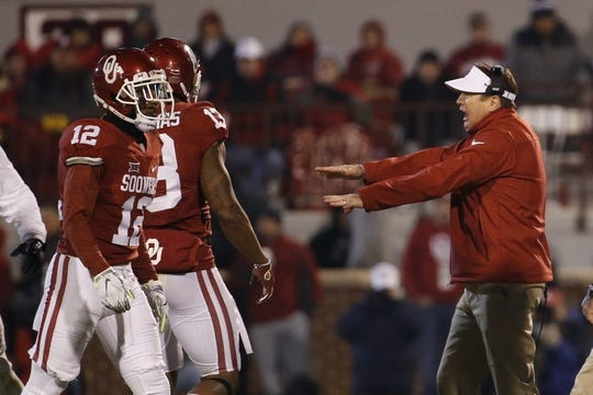 Nov 21, 2015; Norman, OK, USA; Oklahoma Sooners head coach Bob Stoops reacts in front of cornerback William Johnson (12) and safety Ahmad Thomas (13) during the game against the TCU Horned Frogs at Gaylord Family - Oklahoma Memorial Stadium. Mandatory Credit: Kevin Jairaj-USA TODAY Sports