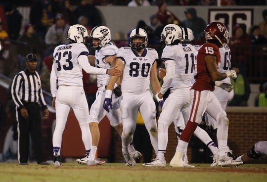 Nov 21, 2015; Norman, OK, USA; TCU Horned Frogs place kicker Jaden Oberkrom (33) celebrates with teammates after scoring during the game against the Oklahoma Sooners at Gaylord Family - Oklahoma Memorial Stadium. Mandatory Credit: Kevin Jairaj-USA TODAY Sports
