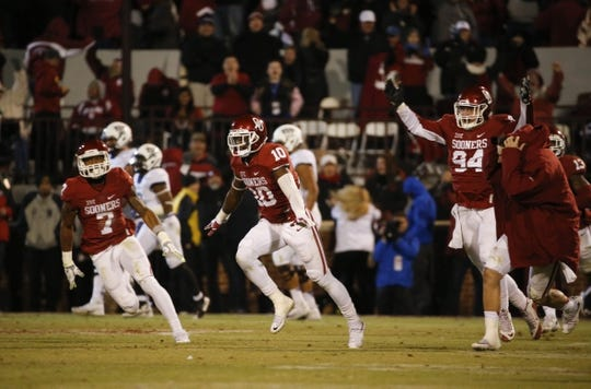 Nov 21, 2015; Norman, OK, USA; Oklahoma Sooners safety Steven Parker (10) celebrates with teammates after knocking down a two point conversion attempt against the TCU Horned Frogs during the fourth quarter at Gaylord Family - Oklahoma Memorial Stadium. Mandatory Credit: Kevin Jairaj-USA TODAY Sports