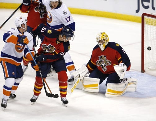 Nov 27, 2015; Sunrise, FL, USA;  Florida Panthers goalie Roberto Luongo (1) makes a save in front of Florida defenseman Brian Campbell (51) and New York Islanders center Casey Cizikas (53) in the first period at BB&T Center. Mandatory Credit: Robert Mayer-USA TODAY Sports