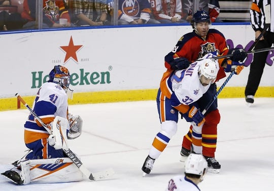 Nov 27, 2015; Sunrise, FL, USA;  New York Islanders goalie Jaroslav Halak (41) attempts to make a save against Florida Panthers center Brandon Pirri (not pictured) in front of Panthers right wing Jaromir Jagr (68) and Islanders defenseman Brian Strait (37) in the first period at BB&T Center. Mandatory Credit: Robert Mayer-USA TODAY Sports