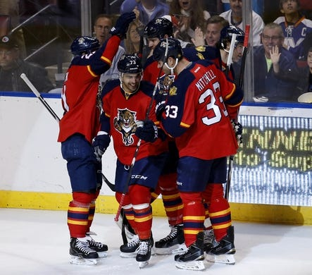 Nov 27, 2015; Sunrise, FL, USA; Florida Panthers center Brandon Pirri (73) celebrates with teammates after scoring a goal in the first period against the New York Islanders at BB&T Center. Mandatory Credit: Robert Mayer-USA TODAY Sports