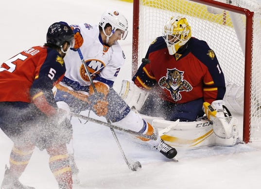 Nov 27, 2015; Sunrise, FL, USA;  Florida Panthers goalie Roberto Luongo (1) makes a save against New York Islanders center Brock Nelson (29) as defenseman Aaron Ekblad (5) looks on in the first period at BB&T Center. Mandatory Credit: Robert Mayer-USA TODAY Sports