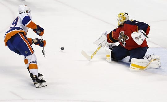 Nov 27, 2015; Sunrise, FL, USA;  Florida Panthers goalie Roberto Luongo (1) makes the final save on a shot by New York Islanders center Brock Nelson (29) during a shootout. The Panthers won 3-2 at BB&T Center. Mandatory Credit: Robert Mayer-USA TODAY Sports