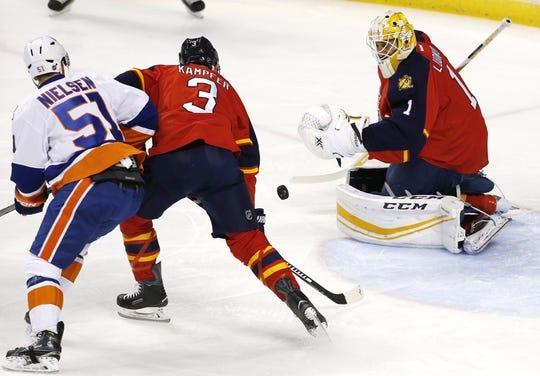Nov 27, 2015; Sunrise, FL, USA;  Florida Panthers goalie Roberto Luongo (1) makes a save in front of defenseman Steven Kampfer (3) New York Islanders center Frans Nielsen (51) in the first period at BB&T Center. Mandatory Credit: Robert Mayer-USA TODAY Sports