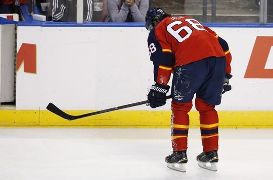 Nov 27, 2015; Sunrise, FL, USA;  Florida Panthers right wing Jaromir Jagr (68) leaves the ice after a collision with center Brandon Pirri (not pictured) in the second period against the New York Islanders at BB&T Center. Mandatory Credit: Robert Mayer-USA TODAY Sports