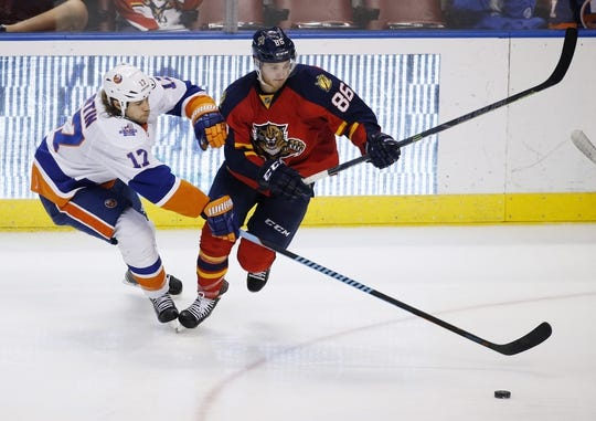 Nov 27, 2015; Sunrise, FL, USA;  Florida Panthers center Connor Brickley (86) and New York Islanders left wing Matt Martin (17) battle for the puck in the third period at BB&T Center. Mandatory Credit: Robert Mayer-USA TODAY Sports
