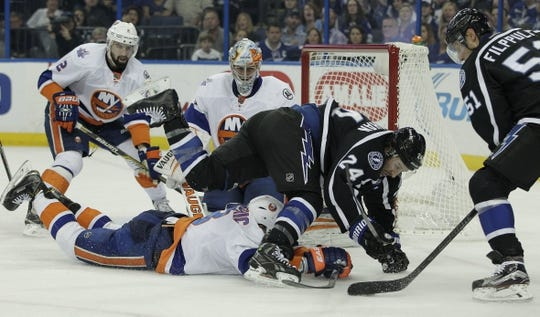Nov 28, 2015; Tampa, FL, USA; New York Islanders defenseman Travis Hamonic (3) dives as Tampa Bay Lightning right wing Ryan Callahan (24) dives over the top in front of New York Islanders goalie Thomas Greiss (1) during the second period at Amalie Arena. Mandatory Credit: Reinhold Matay-USA TODAY Sports