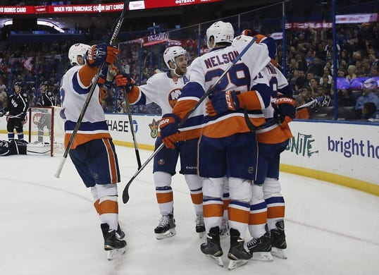 Nov 28, 2015; Tampa, FL, USA; the New York Islanders celebrate their go ahead goal during the third period against the Tampa Bay Lightning at Amalie Arena.The Islanders won 3-2. Mandatory Credit: Reinhold Matay-USA TODAY Sports