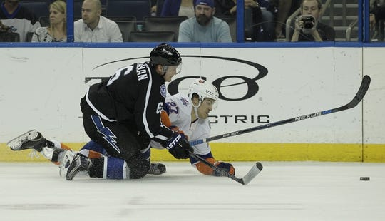 Nov 28, 2015; Tampa, FL, USA; New York Islanders center Anders Lee (27) and Tampa Bay Lightning defenseman Anton Stralman (6) battle for the puck during the third period at Amalie Arena.The Islanders won 3-2. Mandatory Credit: Reinhold Matay-USA TODAY Sports