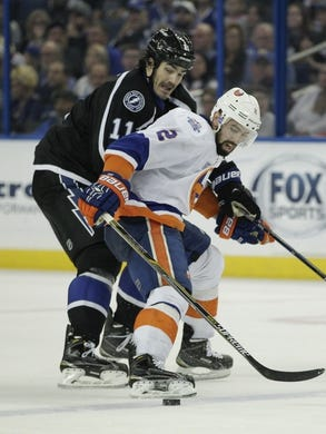 Nov 28, 2015; Tampa, FL, USA; New York Islanders defenseman Nick Leddy (2) and Tampa Bay Lightning center Brian Boyle (11) battle for the puck during the third period at Amalie Arena.The Islanders won 3-2. Mandatory Credit: Reinhold Matay-USA TODAY Sports