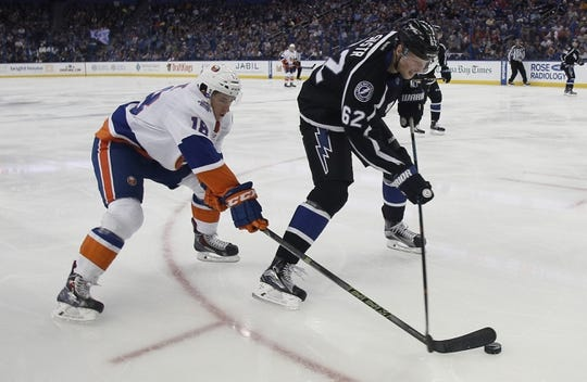 Nov 28, 2015; Tampa, FL, USA; New York Islanders center Ryan Strome (18) and Tampa Bay Lightning defenseman Andrej Sustr (62) battle for the puck during the third period at Amalie Arena.The Islanders won 3-2. Mandatory Credit: Reinhold Matay-USA TODAY Sports
