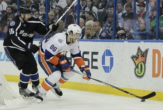 Nov 28, 2015; Tampa, FL, USA; Tampa Bay Lightning defenseman Braydon Coburn (55) chases New York Islanders left wing Nikolay Kulemin (86) during the third period at Amalie Arena.The Islanders won 3-2. Mandatory Credit: Reinhold Matay-USA TODAY Sports