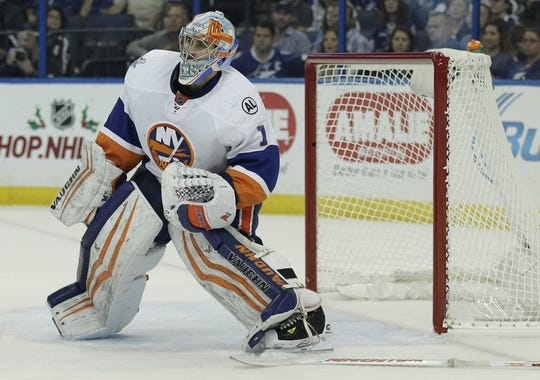 Nov 28, 2015; Tampa, FL, USA; New York Islanders goalie Thomas Greiss (1) waits for an opportune moment to retrieve his stick during the second period against the Tampa Bay Lightning at Amalie Arena. Mandatory Credit: Reinhold Matay-USA TODAY Sports