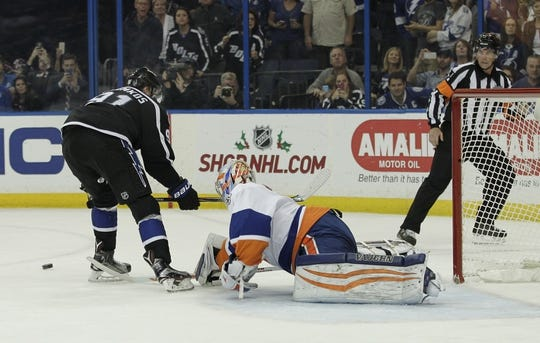 Nov 28, 2015; Tampa, FL, USA; New York Islanders goalie Thomas Greiss (1) poke checks the puck away from Tampa Bay Lightning center Steven Stamkos (91) on a penalty shot during the second period at Amalie Arena. Mandatory Credit: Reinhold Matay-USA TODAY Sports