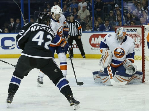 Nov 28, 2015; Tampa, FL, USA; New York Islanders goalie Thomas Greiss (1) makes a save on a shot from Tampa Bay Lightning center Jonathan Marchessault (42) during the second period at Amalie Arena. Mandatory Credit: Reinhold Matay-USA TODAY Sports