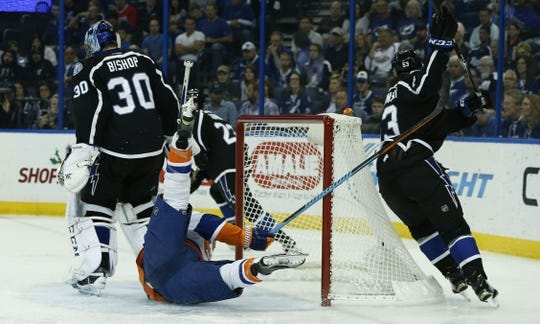 Nov 28, 2015; Tampa, FL, USA; New York Islanders left wing Matt Martin (17) looses an edge and crashes into the net as Tampa Bay Lightning goalie Ben Bishop (30) and defenseman Luke Witkowski (53) move to avoid him during the first period at Amalie Arena. Mandatory Credit: Reinhold Matay-USA TODAY Sports