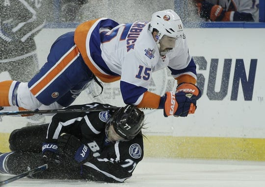 Nov 28, 2015; Tampa, FL, USA; Tampa Bay Lightning defenseman Victor Hedman (77) and New York Islanders right wing Cal Clutterbuck (15) collide during the third period at Amalie Arena.The Islanders won 3-2. Mandatory Credit: Reinhold Matay-USA TODAY Sports