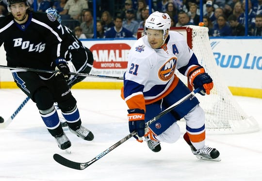 Nov 28, 2015; Tampa, FL, USA; New York Islanders right wing Kyle Okposo (21)  skates during the first period of a hockey game against the Tampa Bay Lightning at Amalie Arena. Mandatory Credit: Reinhold Matay-USA TODAY Sports