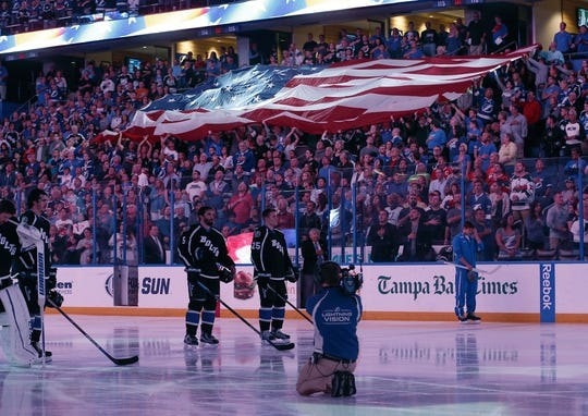 Nov 28, 2015; Tampa, FL, USA; The American Flag is passed among the crowd during the National Anthem before  the first period of a hockey game between the Tampa Bay Lightning and the New York Islanders at Amalie Arena. Mandatory Credit: Reinhold Matay-USA TODAY Sports