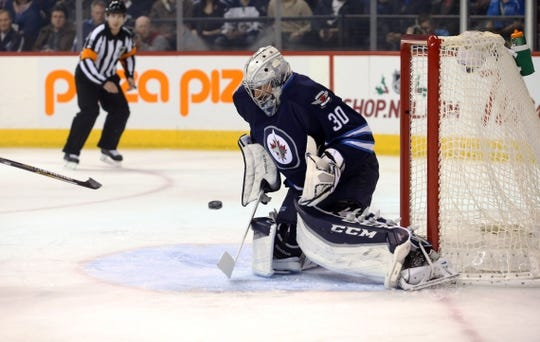 Dec 15, 2015; Winnipeg, Manitoba, CAN; Winnipeg Jets goalie Connor Hellebuyck (30) makes a save on St. Louis Blues center David Backes (not shown) during the first period at MTS Centre. Mandatory Credit: Bruce Fedyck-USA TODAY Sports