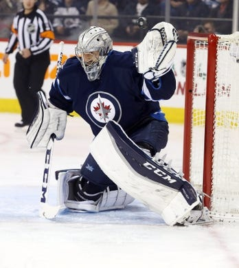 Dec 15, 2015; Winnipeg, Manitoba, CAN; Winnipeg Jets goalie Connor Hellebuyck (30) makes a save during the first period against the St. Louis Blues at MTS Centre. Mandatory Credit: Bruce Fedyck-USA TODAY Sports
