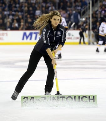 Dec 15, 2015; Winnipeg, Manitoba, CAN; Winnipeg Jets  ice girl cleans the ice during the first period against the St. Louis Blues at MTS Centre. Mandatory Credit: Bruce Fedyck-USA TODAY Sports