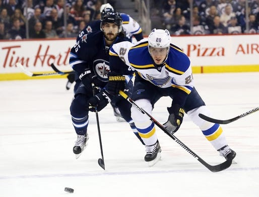 Dec 15, 2015; Winnipeg, Manitoba, CAN; St. Louis Blues left wing Alexander Steen (20) beats Winnipeg Jets center Mathieu Perreault (85) to a loose puck during the first period at MTS Centre. Mandatory Credit: Bruce Fedyck-USA TODAY Sports
