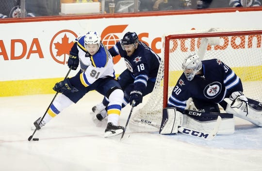 Dec 15, 2015; Winnipeg, Manitoba, CAN; Winnipeg Jets center Bryan Little (18) tries to take the puck away from St. Louis Blues right wing Vladimir Tarasenko (91) during the second period at MTS Centre. Mandatory Credit: Bruce Fedyck-USA TODAY Sports