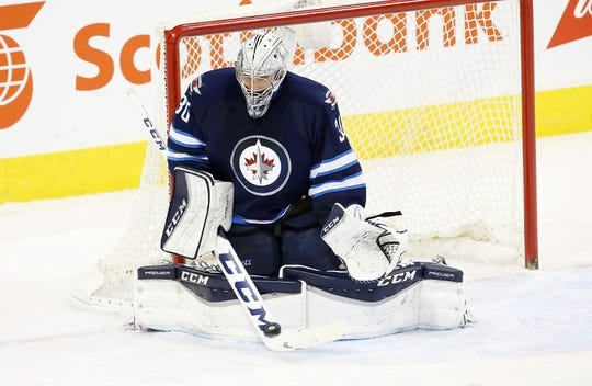 Dec 15, 2015; Winnipeg, Manitoba, CAN; Winnipeg Jets goalie Connor Hellebuyck (30) makes a save during the second period against the St. Louis Blues at MTS Centre. Mandatory Credit: Bruce Fedyck-USA TODAY Sports