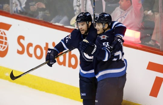 Dec 15, 2015; Winnipeg, Manitoba, CAN;  Winnipeg Jets right wing Drew Stafford (12) celebrates his goal with Winnipeg Jets center Mark Scheifele (55) during the second period against the St. Louis Blues at MTS Centre. Mandatory Credit: Bruce Fedyck-USA TODAY Sports