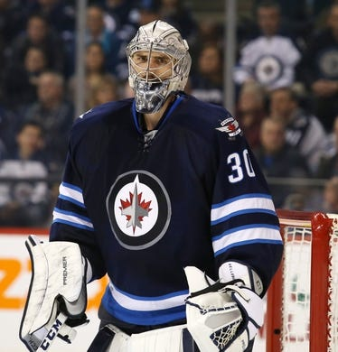 Dec 15, 2015; Winnipeg, Manitoba, CAN;  Winnipeg Jets goalie Connor Hellebuyck (30) watches as play is stopped during the third period against the St. Louis Blues at MTS Centre. St. Louis Blues wins 4-3. Mandatory Credit: Bruce Fedyck-USA TODAY Sports