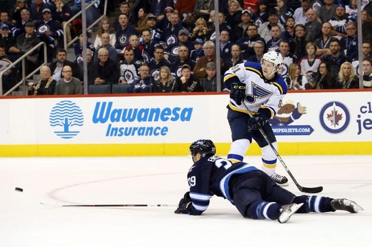 Dec 15, 2015; Winnipeg, Manitoba, CAN;  St. Louis Blues right wing Vladimir Tarasenko (91) passes the puck over Winnipeg Jets defenseman Tobias Enstrom (39) to St. Louis Blues left wing Alexander Steen (not shown) during the third period at MTS Centre. St. Louis Blues wins 4-3. Mandatory Credit: Bruce Fedyck-USA TODAY Sports