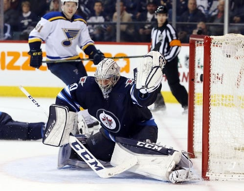 Dec 15, 2015; Winnipeg, Manitoba, CAN; St. Louis Blues left wing Alexander Steen (not shown) puts the puck past Winnipeg Jets goalie Connor Hellebuyck (30) during the third period at MTS Centre. St. Louis Blues wins 4-3. Mandatory Credit: Bruce Fedyck-USA TODAY Sports