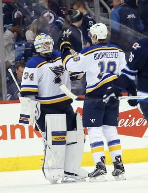 Dec 15, 2015; Winnipeg, Manitoba, CAN; St. Louis Blues goalie Jake Allen (34) celebrates with teammate defenseman Jay Bouwmeester (19) after the third period against the Winnipeg Jets at MTS Centre. St. Louis Blues wins 4-3. Mandatory Credit: Bruce Fedyck-USA TODAY Sports