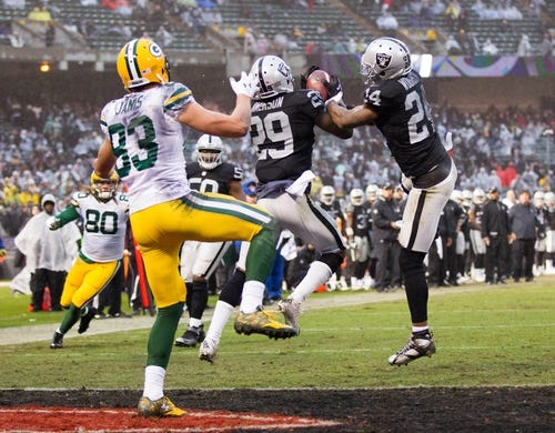Dec 20, 2015; Oakland, CA, USA; Oakland Raiders cornerback David Amerson (29) intercepts a pass intended for Green Bay Packers wide receiver Jeff Janis (83) during the fourth quarter at O.co Coliseum. The Green Bay Packers defeated the Oakland Raiders 30-20. Mandatory Credit: Kelley L Cox-USA TODAY Sports