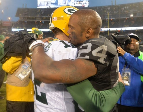 Dec 20, 2015; Oakland, CA, USA; Green Bay Packers quarterback Aaron Rodgers (12) and Oakland Raiders free safety Charles Woodson (24) embrace after an NFL football game at O.co Coliseum. The Packers defeated the Raiders 30-20. Mandatory Credit: Kirby Lee-USA TODAY Sports